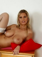 Busty gal in white stockings fucking herself with the use of huge dildo