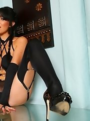 Stunning Lexi in sheer black nylon lingerie, stockings and suspenders.