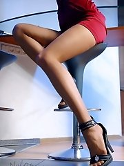 Slim leggy blonde in sheer sexy pantyhose and stilettos