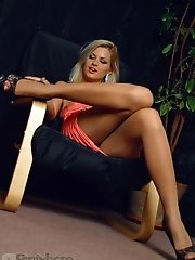 Lustful busty blonde in tan pantyhose on the sexy legs